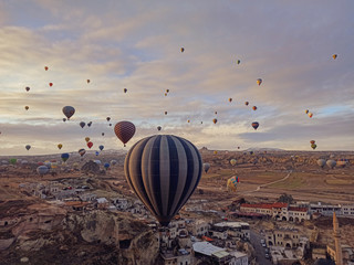 Montage in der Fensternische Lavendel Colorful hot air balloons flying at the sunrise with rocky landscape in Cappadocia, Turkey