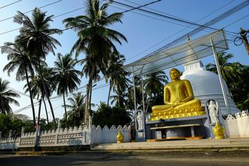 Buddha statue on a street in Galle, Sri Lanka.