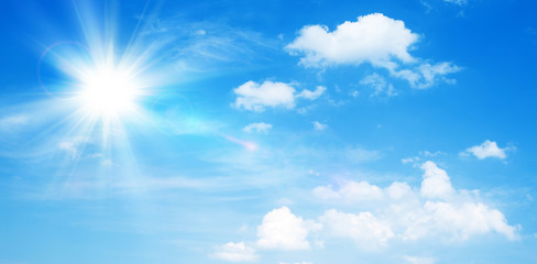 Sunny natural background, blue sky with sun and white clouds. Fototapete