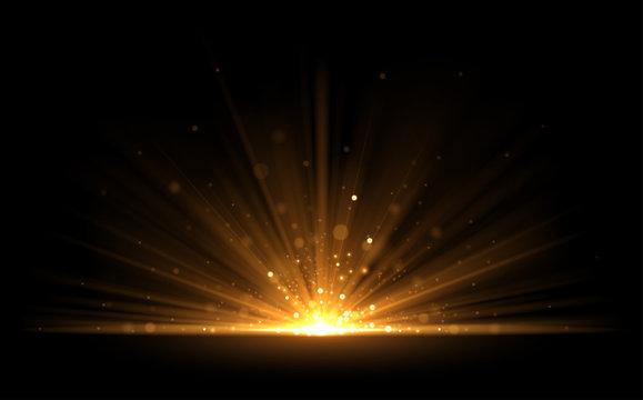 Golden glow light effect on black background