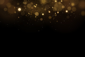 Wall Mural - Abstract magical flying lights with golden glares bokeh on a black background. Christmas light effect. Vector illustration