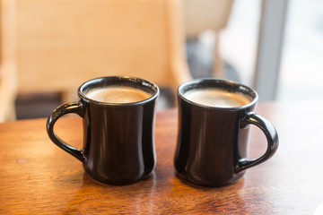 Two cup of hot coffee on wooden table