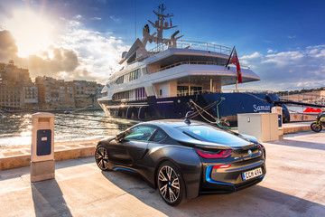Birgu, Malta - January 10, 2019: Sport electric car BMW I8 parked at the marina in Birgu, Malta. The BMW i8 is a plug-in hybrid sports car developed by BMW.