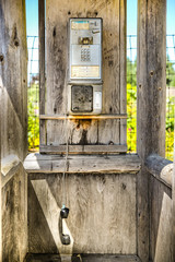 Old payphone in a wooden shed