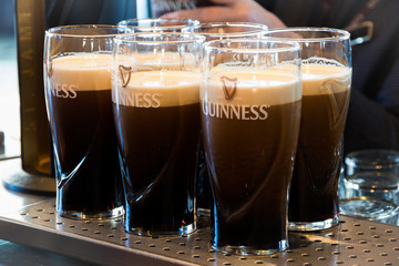 DUBLIN, IRELAND - FEB 15, 2014: Pints of Guinness are being served in a pub in Dublin, Ireland