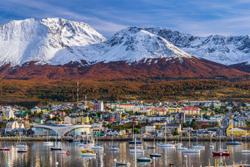 Colorful scene view of the bay and Ushuaia city against Andes mountains during autumn sean Fotomurales