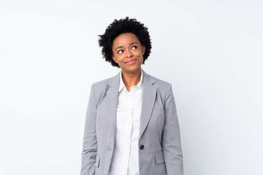 African american business woman over isolated white background laughing and looking up