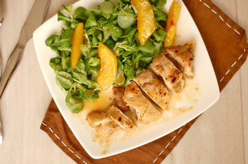 Wall Mural - Chicken fillets white lettuce, peach and sweet and sour sauce
