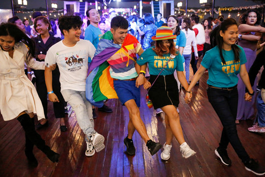 Participants dance to the music during the Yangon Pride Boat Parade in Yangon