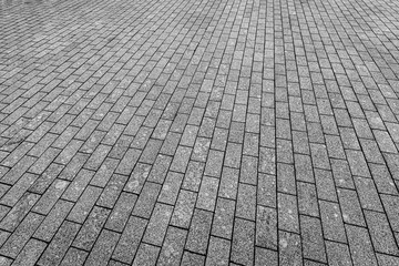 Top view on paving stone road. Old pavement of granite texture. Street cobblestone sidewalk. Abstract background for design. Fototapete