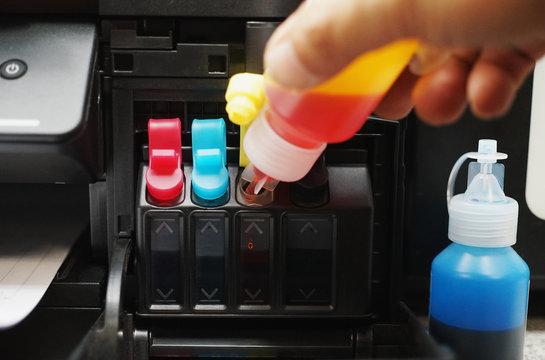 Technicians Refill ink cartridges, printer Inkjet colors.Printer Repairs and Maintenance inkjet or Laser printers concept