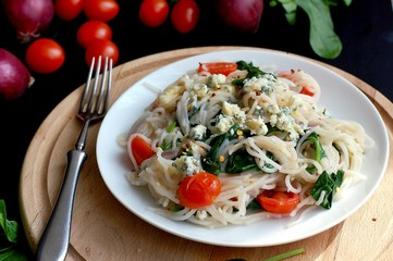 Wall Mural - Vegetable salad with rice noodles, spinach, cherry tomato, onion and cheese