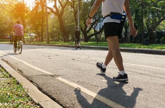 Running man walking exercise at public park .aerobic endurance training.selective focus