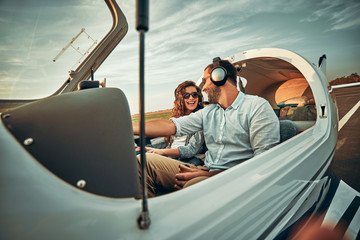 Couple in love in a small private airplane