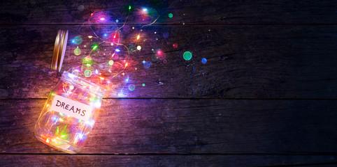 Fototapeta Dreams Concept - Colorful Lights In Open Jar obraz