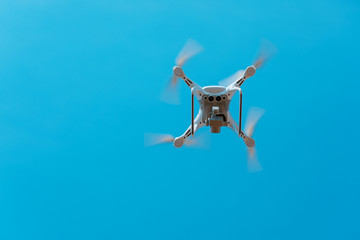 Wall Mural - drone flying over the blue sky background
