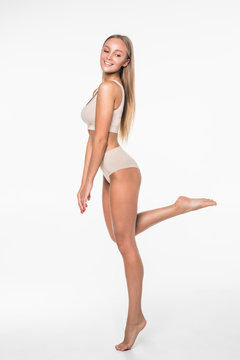 Full height of young pretty woman with perfect body standing isolated on white background. Fitness and diet concept.