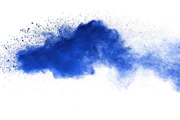 Abstract brown powder explosion. Closeup of blue dust particle splash isolated on white  background