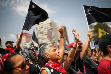 Women gesture during an anti-government protest at Plaza Italia, now known as Plaza de la Dignidad (Dignity Square), in Santiago