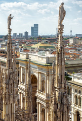 Autocollant pour porte Milan Milan Cathedral spires overlooking the Galleria Vittorio Emanuele II, Milan, Italy. Scenery of luxury Gothic roof with statues.