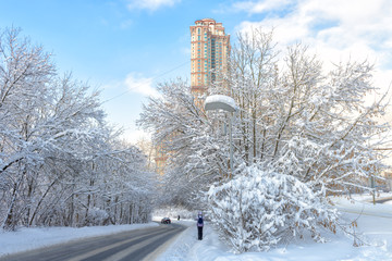 Moscow after snowfall, Russia. Scenic view of road and modern tall buildings. Cold and frost in winter Moscow city. Beautiful snowy urban landscape.