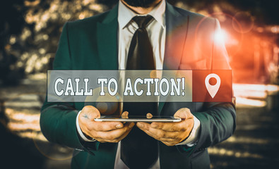 Writing note showing Call To Action. Business concept for exhortation do something in order achieve aim with problem Businessman in blue suite with a tie holds lap top in hands