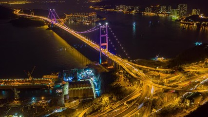 Fototapete - Hyperlapse or Dronelapse Aerial view of Traffic of car at Tsing ma bridge in Tsing yi area of Hong Kong at night
