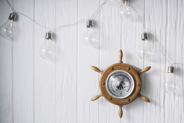 Sea barometer on a white wooden background