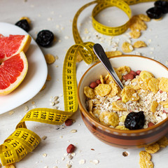 Diet breakfast. Cereals, grapefruit and dried fruits.