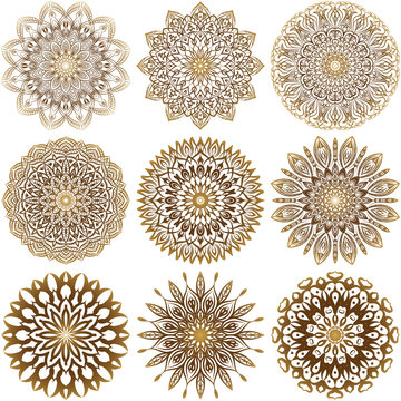 A collection of nine gold mandalas on a white background. Luxurious vector ornament.