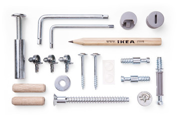 Ikea, set of tools and mounting elements for furniture on white background. Top view.