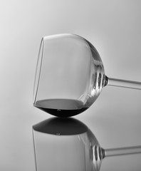 Wine Glass Still Life: Black and white image of a wine glass on its side with reflection.