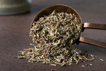 Dried Thyme Spilled from a Teaspoon