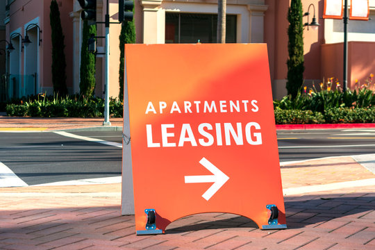 Apartments leasing sign promotes the rental property and shows direction where the rental office is located