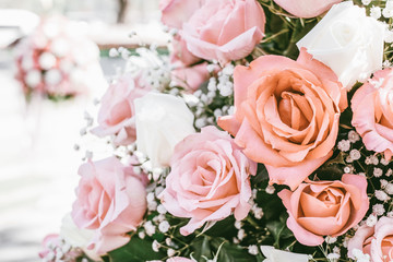 Wall Mural - Rose bouquet in wedding day, love and romantic background. Pink rose flower blossom in vintage pastel color. flowers in spring.
