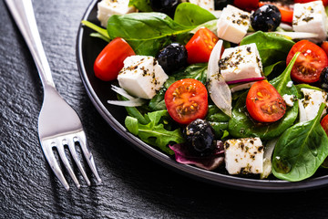 Fresh greek salad - feta cheese, tomato, lettuce, black olives and onion Fototapete