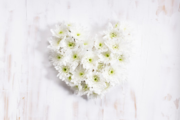 heart shaped of white flowers, top view