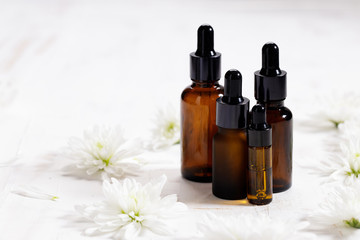 herbal oil and white flowers