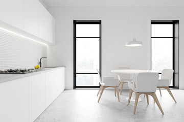 Loft white kitchen with round table