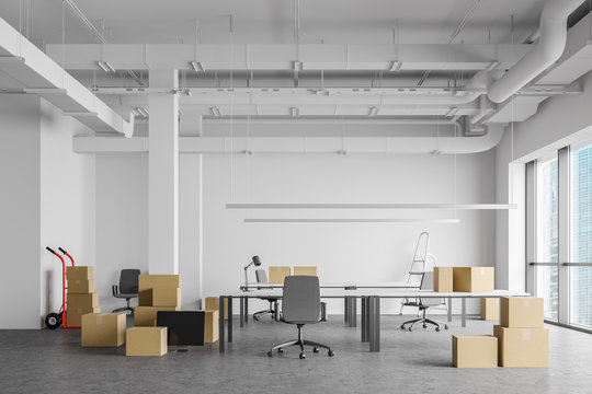 Boxes in open space office, moving concept