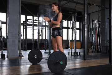 Attractive muscular fit woman exercising building muscles.