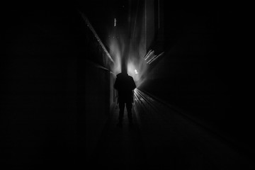 Dark corridor with cabinet doors and lights with silhouette of spooky horror person standing with different poses.