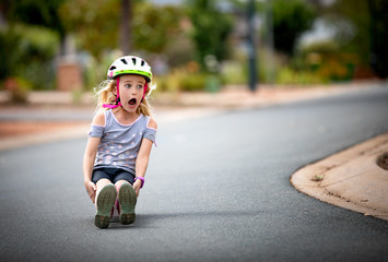 Little girl coming down the hill on her skateboard