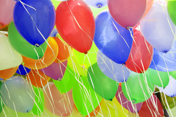 many colorful balloons, filling the picture