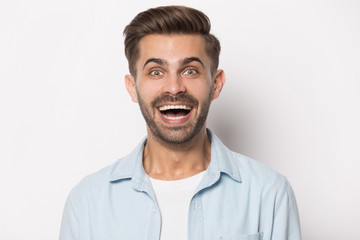 Excited millennial guy heard unbelievable good news.