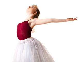 Young beautiful ballerina in white tutu and pointe shoes doing dancing pose