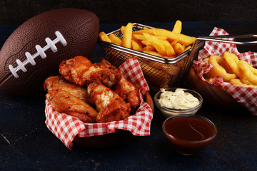 Papiers peints Ecole de Danse chicken wings, fries and onion rings for football on a table. Great for Bowl Game party