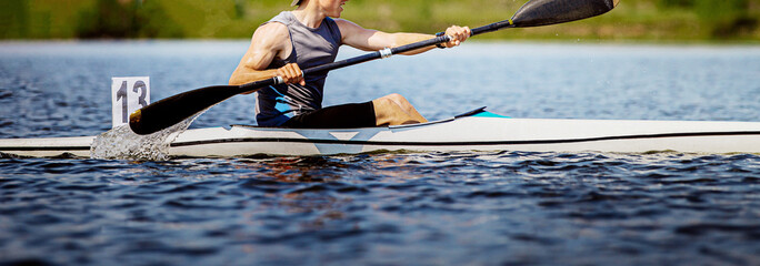 close up athlete kayaker rowing kayaking competition race Fototapete