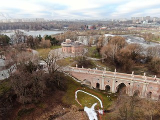 Poster Cappuccino Aerial view flying over a public city park with beautiful architecture and ancient buildings. Beautiful urban landscape from the drone. Tsaritsyno. Moscow
