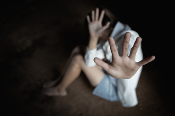 concept photo of sexual assault, traumatized young women.  Stop violence and rape concept.